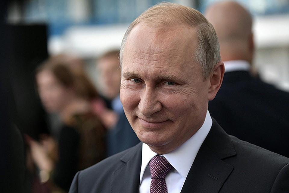Улыбающийся В.В.Путин