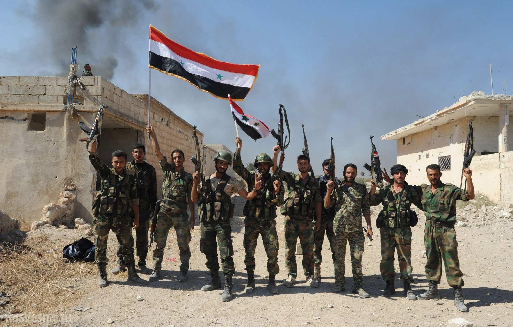 Сирийские войска в освобожденном городе