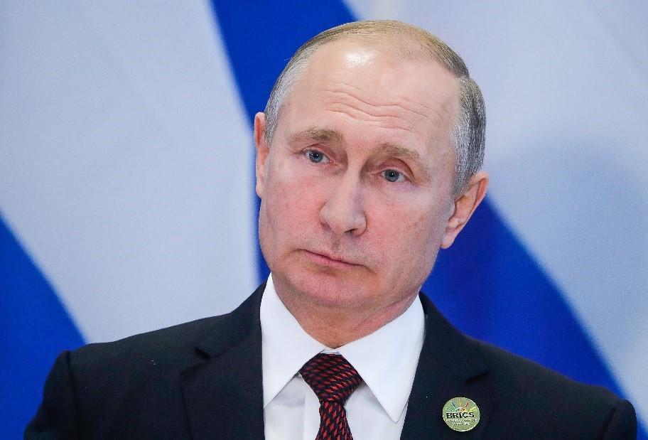Путин со значком БРИКС