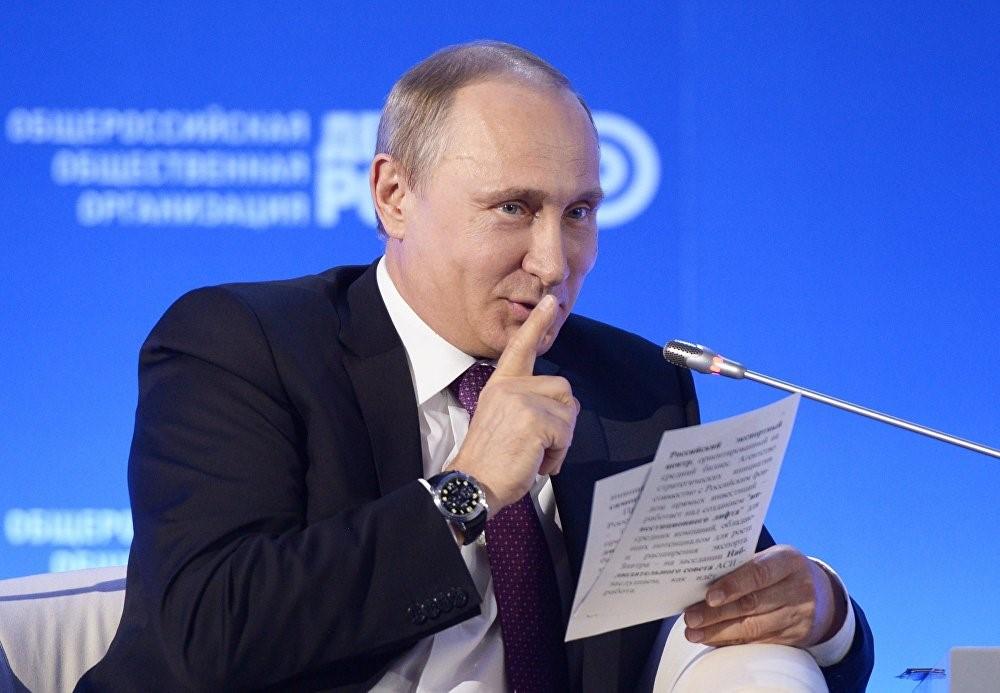 Улыбающийся Путин