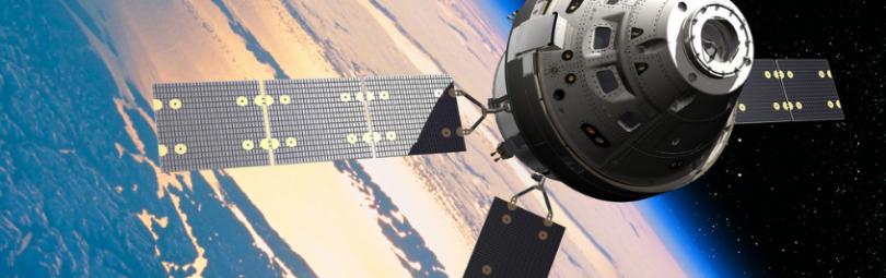 Спутник на фоне Земли
